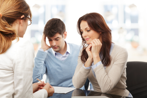 Photo of a couple meeting with a family law mediator to resolve a marital dispute