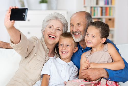 Photo of grandparents enjoying time with their grandchildren